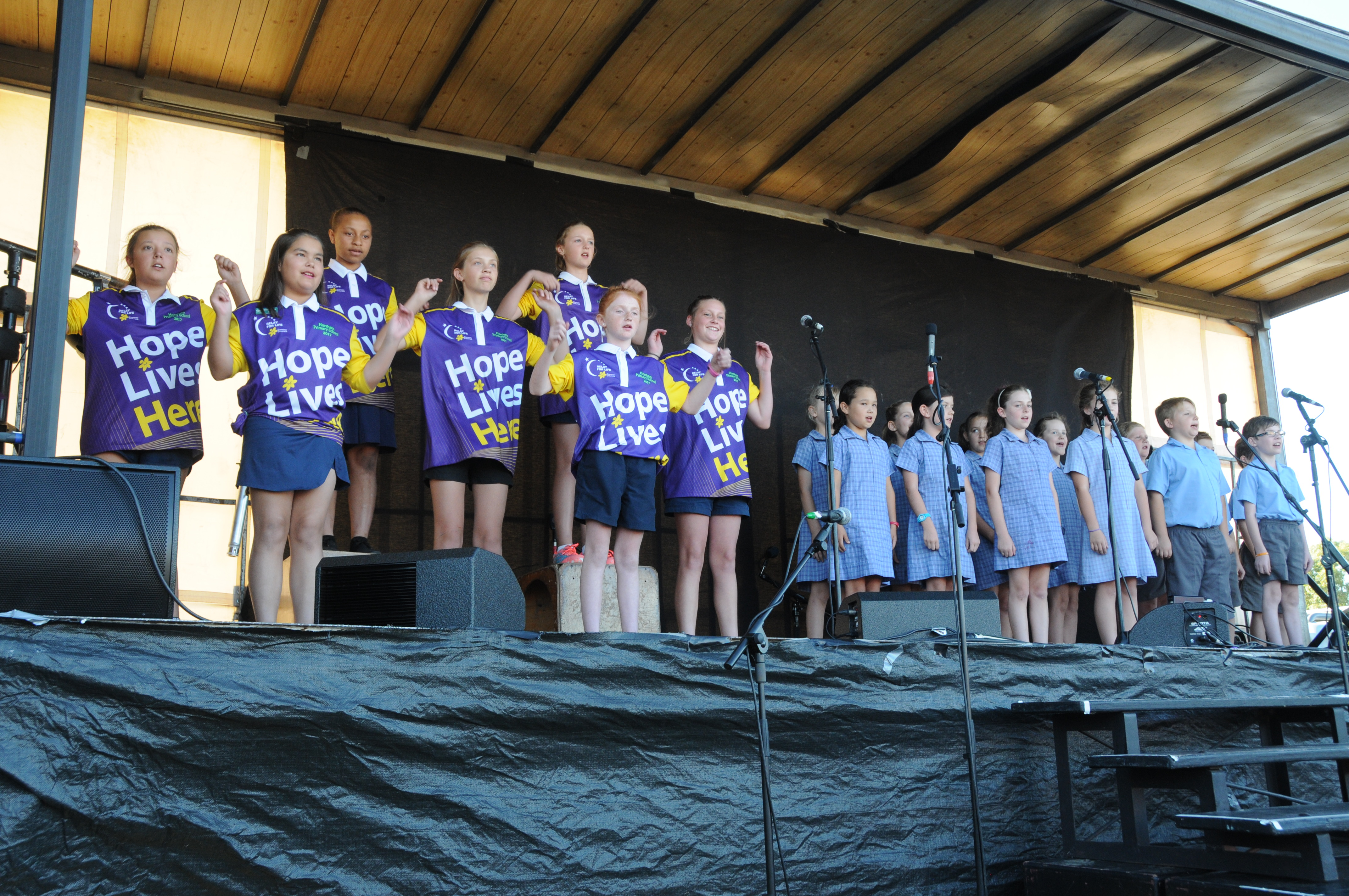 Image - Horsham and District Relay for Life, 170317. Horsham Primary School signing choir, and Holy Trinity Lutheran School pupils perform the national anthem.