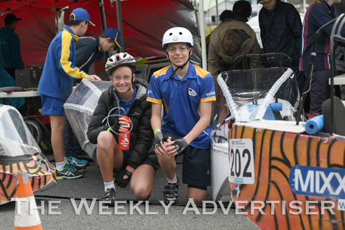 Image - Alexandra Salter and Jason Reichelt get ready to race a Holy Trinity Lutheran School HPV for the first Human Powered Vehicle 'expo' at Dimboola.